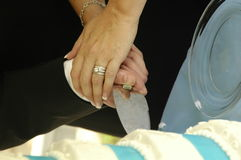 Couple cutting wedding cake Stock Image