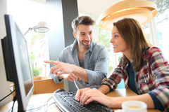 Couple in cybercafe websurfing Royalty Free Stock Image