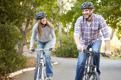 Couple On Cycle Ride In Countryside Stock Image