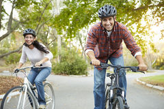 Couple On Cycle Ride In Countryside Stock Photography