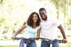 Couple On Cycle Ride in Park stock image
