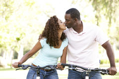 Couple On Cycle Ride in Park. African American Couple On Cycle Ride in Park royalty free stock photo
