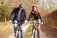 Couple On Cycle Ride In Winter Countryside Royalty Free Stock Photo