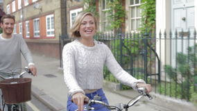 Couple Cycling Along Urban Street Together stock video footage