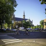 A couple cycling in Charlottetown in the morning with St.Dunstan`s Basilica Cathedra in the background royalty free stock photos