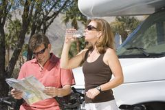 Couple On Cycling Holiday With Recreational Vehicle Stock Images