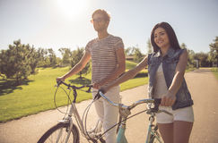 Couple cycling in park Stock Images
