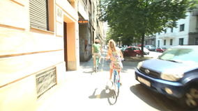 Couple cycling. In town on sidewalk lane stock video footage