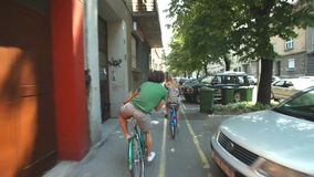 Couple cycling. In town on sidewalk lane stock footage