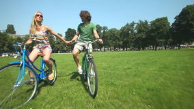 couple cycling stock footage