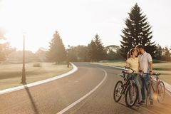 Couple of cyclist resting on the road. royalty free stock photo