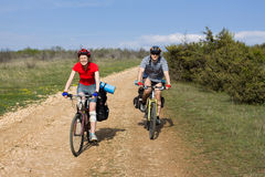 Couple of cyclists have a bicycle travel. Stock Photo