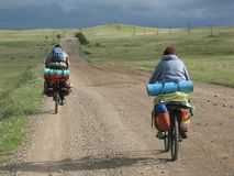 Couple of cyclists have a bicycle travel. Bicycle travel. Couple of cyclists go to road. Bike Touring royalty free stock photos
