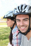 Couple of cyclists wearing helmets Royalty Free Stock Photo