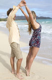 Couple dance on the beach in Hawaii Stock Images
