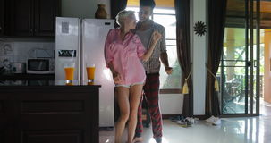 Couple Dance In Kitchen Happy, Young Cheerful Man And Woman Morning In Modern Apartment stock video footage