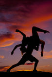 Couple dance he lifts her up on shoulder arms legs out Stock Photo
