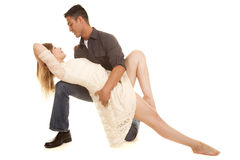 Couple dance pose white dress lay back on knee facing Royalty Free Stock Image