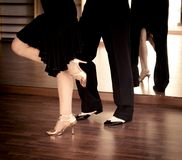 Male and female legs dancing latin rhythms and swing royalty free stock photos