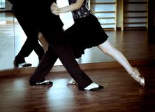 Male and female legs dancing latin rhythms and swing royalty free stock images