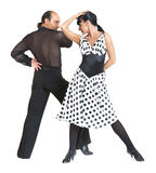 Couple dancers latina style. Posing on white background Royalty Free Stock Photos