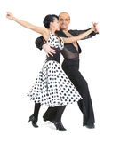 Couple dancers latina style. Poing on white background Stock Images