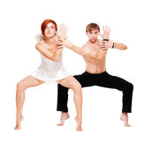 Couple of dancers posing. Over white background Stock Photo