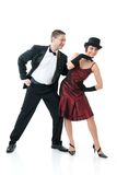 Couple dancing. Attractive couple dancing. Isolated over white Stock Images