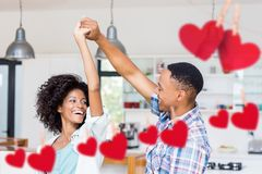 Couple dancing against hanging red hearts Royalty Free Stock Photo