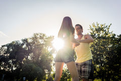 Couple dancing bachata in park backlit training dip figure royalty free stock photos