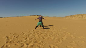 Couple dancing barefoot in desert, Egypt stock video