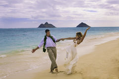 Couple dancing on the beach. Newley wed couple dancing on the beach at Lanikai, Hawaii Royalty Free Stock Photography