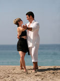Couple dancing on the beach. Young couple dancing on the beach Stock Photography