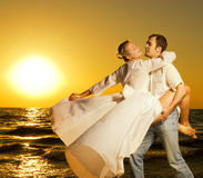 Couple dancing on the beach Royalty Free Stock Image