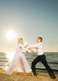 Couple dancing on a beach Stock Photo