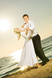 Couple dancing on a beach Royalty Free Stock Photo