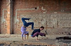 Couple dancing breakdance on the street Stock Images