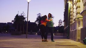 Couple dancing in the city near the building. At the evening stock video footage