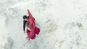 Couple dancing in the desert. view from the top. stock video footage