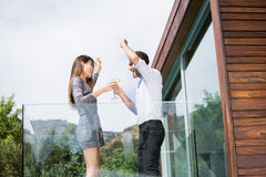 Couple dancing while drinking cocktails in balcony Royalty Free Stock Photography