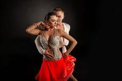 Couple dancing, elegant man and woman in studio royalty free stock image