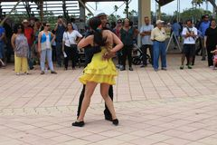 Couple dancing at a festival in Miami. Couple performing in traditional dress dancing salsa in front of crowd at a rodeo festival in Miami, Florida. outdoors Stock Photo