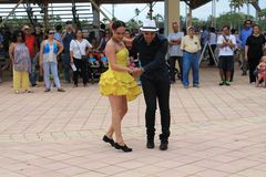 Couple dancing at a festival in Miami. Couple performing in traditional dress dancing salsa in front of crowd at a rodeo festival in Miami, Florida. outdoors Stock Photography