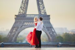 Couple dancing in front of the Eiffel tower in Paris, France. Beautiful romantic couple dancing in front of the Eiffel tower in Paris, France Royalty Free Stock Photography