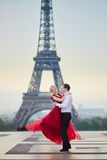 Couple dancing in front of the Eiffel tower in Paris, France. Beautiful romantic couple dancing in front of the Eiffel tower in Paris, France Stock Photography