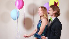 Couple dancing funny in photo booth. Cute smiling couple dancing funny in photo booth stock video
