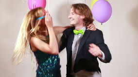 Couple dancing funny in photo booth. Young happy couple dancing funny in photo booth stock footage