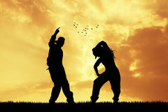 Couple dancing hip hop at sunset Royalty Free Stock Photos