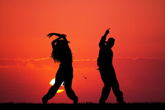 Couple dancing hip hop at sunset Royalty Free Stock Photo