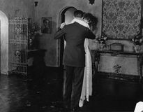 Couple dancing at home. (All persons depicted are no longer living and no estate exists. Supplier grants that there will be no model release issues Royalty Free Stock Image